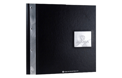 Black coach faux leather binder cover with aluminum strip and aluminum plate embossed with a logo.