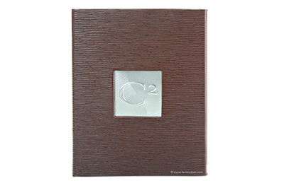 Rich brown faux leather iPad binder embossed in a horizontal reed pattern and an embossed aluminum plate.