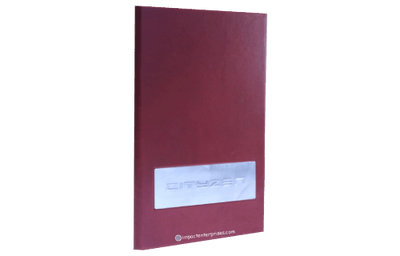 Deep red menu cover with an aluminum plate set in a window.