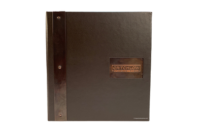 Black coach faux leather binder cover with riveted dark copper treatment.