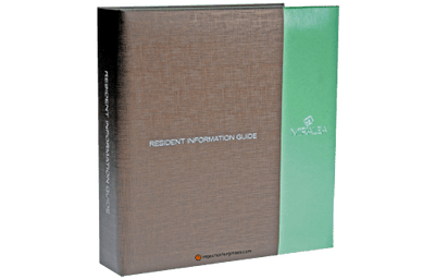 Bronze fabric married to a mint green faux leather guest service directory cover with silver foil debossed artwork and blind debossed artwork.
