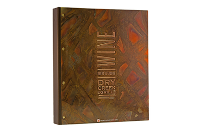 Recycled copper menu cover with a mosaic stroked finish.