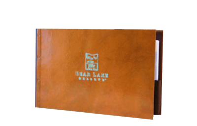 Natural copper landscape binder cover with natural patina around the embossed logo.