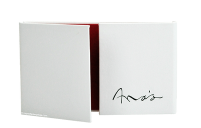 White Euro faux leather menu cover with black foil debossed artwork. Interior panels are lined in a vibrant red bookcloth.