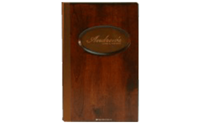 Solid cherry , stained mahogany menu cover with medium copper plate embossed with artwork.