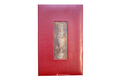 Red Coach faux leather menu cover with dark brass plat with embossed and buffed artwork.
