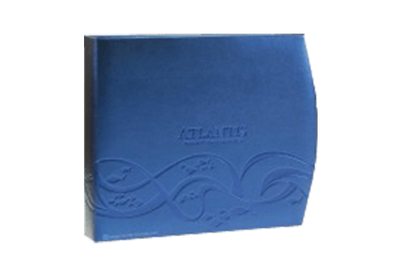 Electrifying blue metallic faux leather guest service directory cover with the right edge in a crescent shape and blind debossed artwork.
