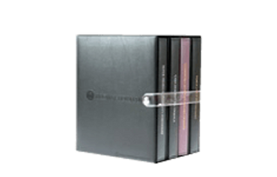 Binder and slipcase with a clear snap strap closure.