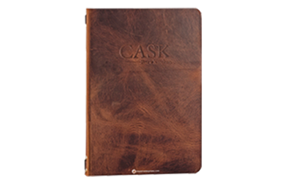 Rich medium brown solid thick slab leather menu cover with blind debossed artwork.