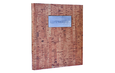 Napa faux cork menu cover with an embossed aluminum plate.