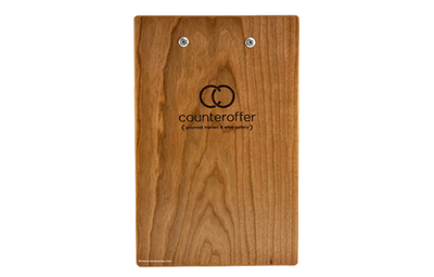 Cherry veneer clipboard menu with custom lever clip and laser-engraved artwork.