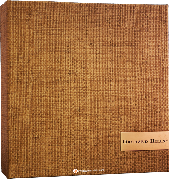 Faux grasscloth binder with engraved and color-filled medallion logo plate in cover
