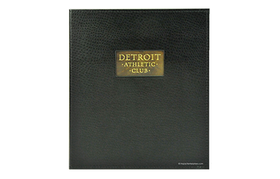 Rich black faux ostrich leather binder with an embossed and buffed brass plate.