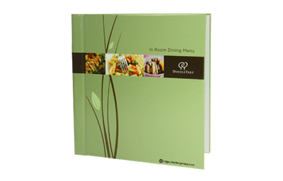 Recycled paper guest service directory cover with soy ink and eco-friendly gloss laminate.