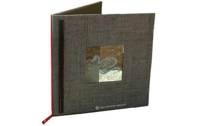 Mocha brown grasscloth menu cover with tinted acrylic plaque with sandblasted artwork.
