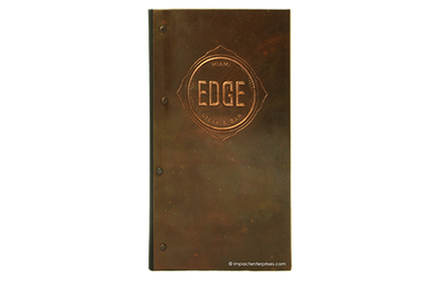 Copper metal check presenter with a logo embossed and buffed in the front cover.