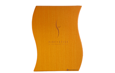 "Orange vinyl menu cover with vertically embossed 'reed' pattern and an ""S"" design shape."