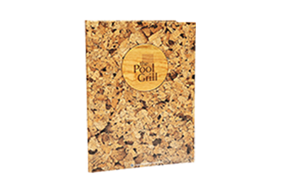 Durable faux cork menu cover with laser-engraved wood plaque and foil debossed artwork.