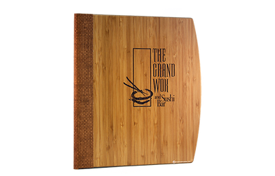 Dark bamboo veneer menu cover with a grasscloth quarterbind spine and laser-engraved artwork.