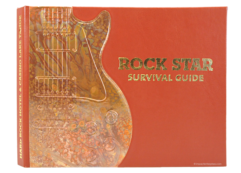 faux leather binders with handcrafted copper guitar-shaped tipon on cover and foil stamped logo for Hard Rock Hotel