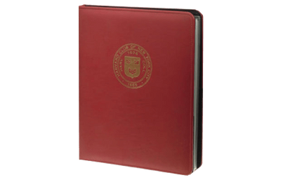 Red faux leather directory cover with gold foil debossed logo.