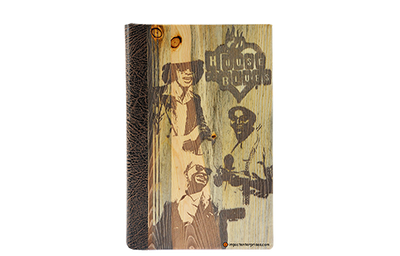 Blue pine binder cover with full cover engraved artwork and the spine is distressed faux leather.