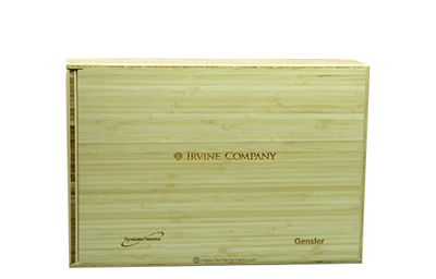 Light colored thin reed bamboo clamshell box binder with laser-engraved artwork.