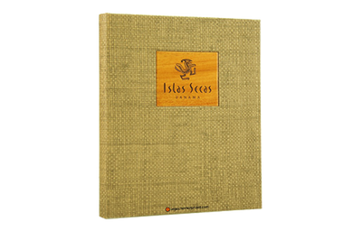 Light brown grasscloth binder cover with a laser-engraved solid mahogany plaque.