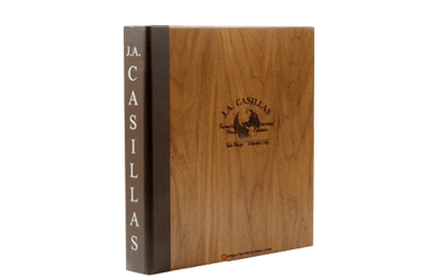 Solid walnut binder cover with rich brown faux leather quarterbind spine and laser-engraved artwork.