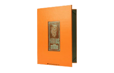 Tangerine faux leather menu cover with copper plate embossed with artwork.