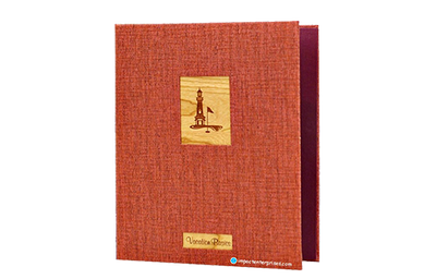 Rich red faux grasscloth directory cover with 2 solid wood plaques.