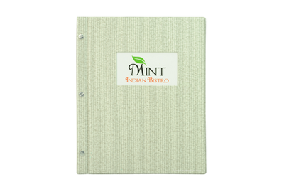 Mint green faux grasscloth menu cover with a laminated photo.