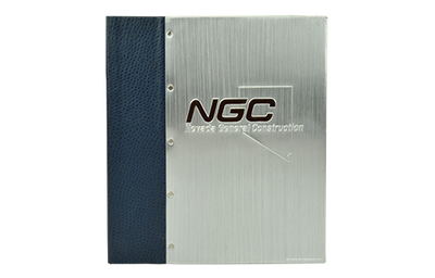 Metal binders with handcrafted aluminum and baby ostrich faux leather quarterbind spine.