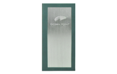 Aqua green faux leather wine list cover with a vertical linen stroked aluminum embossed with artwork.