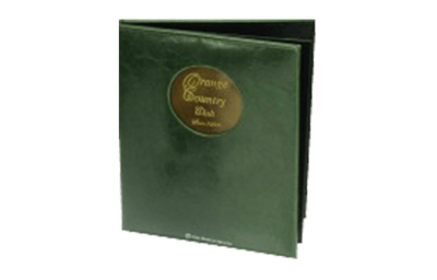 Dark green leather binder with brass plate logo in a round cut out window