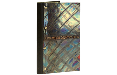 Mosaic copper natural patina finish menu cover with buffed and embossed artwork and faux leather spine.