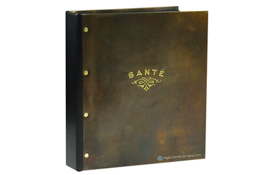 Dark olive brass directory cover with rivets and black faux leather spine.