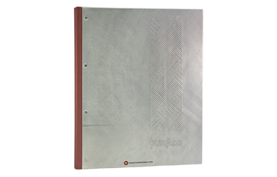 Brushed metal menu with embossed pattern on front and leather spine