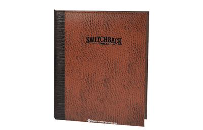 Brown leather menu with dark brown leather spine and foil debossed logo