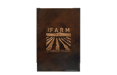 Dark brown metal menu with image of a farm