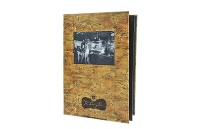 Cork menu cover with an embossed tree root pattern and an antiquated laminated photograph with black foil debossed artwork.