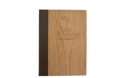 Wood menu with dark brown leather spine and engraved logo