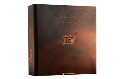 Dark copper binder with rivets and embossed artwork on front and spine