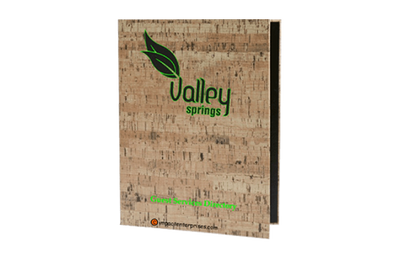 Faux cork binder cover with a green and black foil debossed artwork.