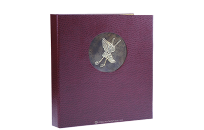 Burgundy leather binder with embossed brass plate