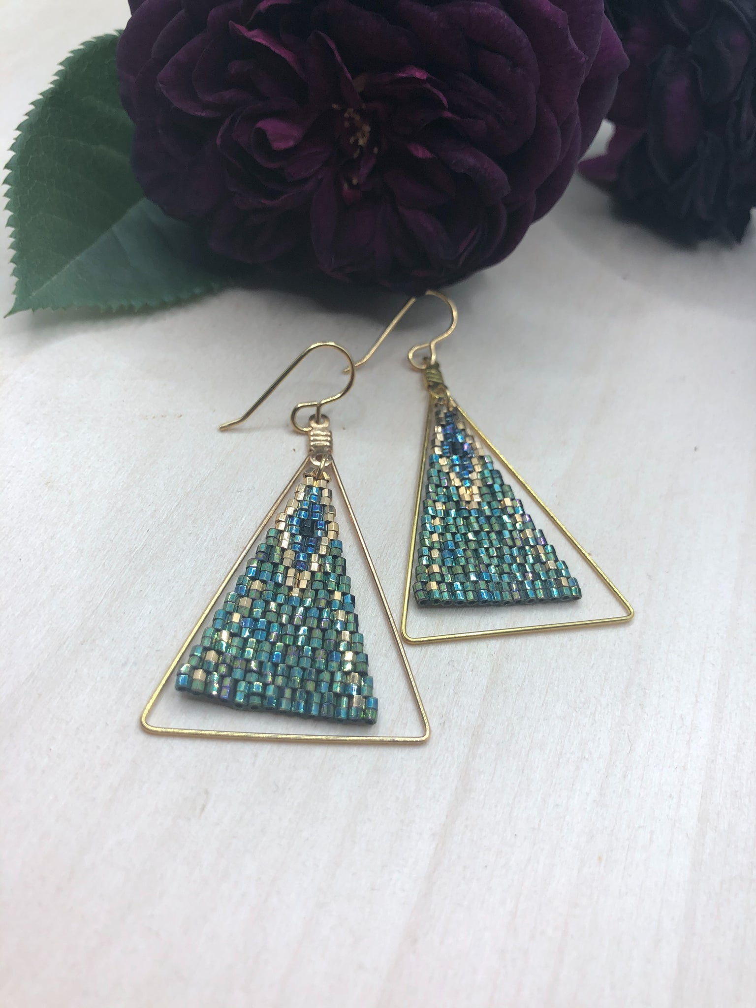 Framed Peacock Triangles
