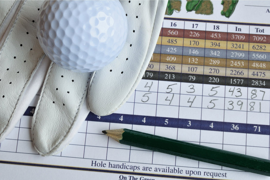 golf score card with glove and ball