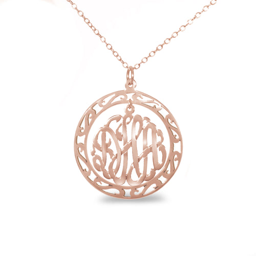 rose gold-plated silver round monogram necklace hanging inside a hollow teardrop pendant