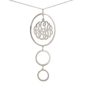 silver circular drop pendant necklace with monogram inside top oval pendant
