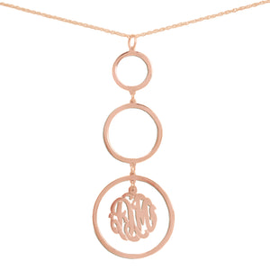 rose gold-plated silver necklace with three hanging circle pendants with a monogram inside bottom pendant